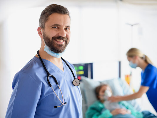 Portrait of doctor in quarantine in hospital, looking at camera. Coronavirus concept.